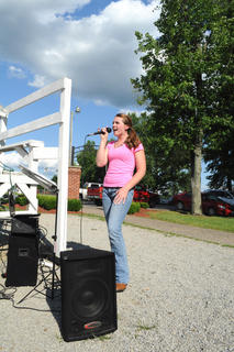 Kristie Brady, 18, New Haven, sings the national anthem at the kick-off of the New Haven/Rolling Fork Baptist Church Adult league kickball game June 5 at the New Haven City Park.