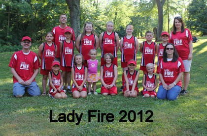 The Nelson County Lady Fire were machine-pitch tournament champs at Dean Watts Park. Team members include (front) Haley Foster, Julie Mattingly, Sarah Riley, Hannah Riley, Reagan Carter, Cathryn Cammack, Shari Mattingly, (back) Daniel Riley, Summer Sanders, Jim Cammack, Rebekah Welch, Kaylee Reynolds, Mackenzie Ryan, Leanne Sunderland, Shelby Drury, Jorja Mays and Terra Reynolds.