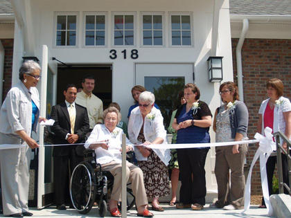 The first New Haven librarian, Nanny Head Johnson, cuts the ribbon for the New Haven Branch grand opening May 6.