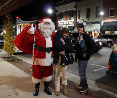 Denise Hagan, Isaac Hagan, 3, and Luke Clark, 15, of Holy Cross and Culvertown, pose with Santa Claus at Light Up Bardstown Nov. 25.