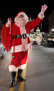 Santa Claus waves at the people who flocked to Light Up Bardstown, a brand new event Nov. 25, 2011, during which downtown businesses stayed open late and Christmas lights to match a completed downtown Streetscape lit the streets.