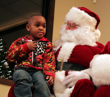 LaBront Hocker, 4, visited Santa Claus along with his brothers and cousins at Light Up Bloomfield Nov. 26 at the Bloomfield Civic Center.