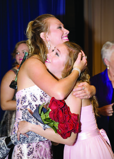 Hannah Welch, last year's Distinguished Young Woman, hugs Madlyn Beasley after she is crowned the 2013 Nelson County Distinguished Young Woman.