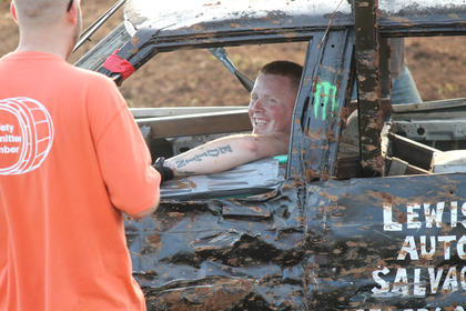 Driver Matt Edlin of New Haven has a laugh with a buddy after competing in the Demolition Derby Saturday night at the fair.