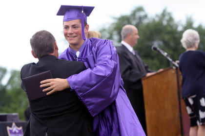 Matthew Bond shakes hands and hugs Bardstown City Schools Superintendent Brent Holsclaw after he received his diploma Saturday at Bardstown High School's graduation.