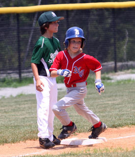 Charlie Evans of the Nelson County 8-year-old All-Stars rounds third after a base hit.