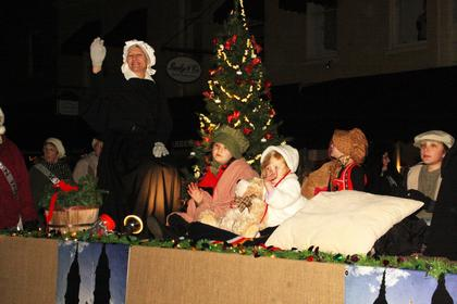 "The Sisters of Charity of Nazareth will celebrate 200 years in 2012. Their float in the parade depicted Mother Catherine Spalding, the founder of the congregation, and her ""orphans."""
