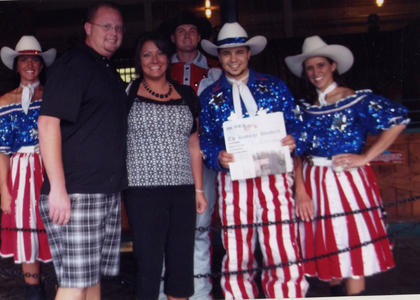 Bobby Simpson and Amanda Cissell pose with performers and The Kentucky Standard at the Dixie Stampede in Pigeon Forge, Tenn., May 17.