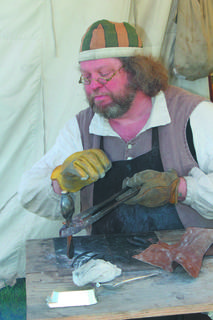 Pewterer Darryl Sheldon, makes spoons.
