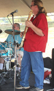 Members of the band On the Edge perform for a crowd during the Bloomfield Picnic in the Park.