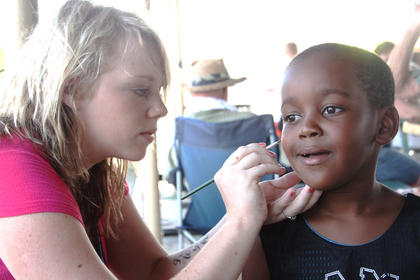 Aidan Harrison, Bardstown, gets his face painted at the picnic by Daire Cecil, Bardstown.