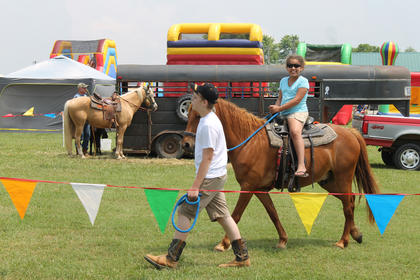 The BBQ Festival had plenty of activities for children. Here, Kady Clodfeltner of Elizabethtown, rides a pony.