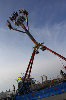 Fairgoers hang on as they reach the zenith of one of the many rides at the Nelson County Fair this week.