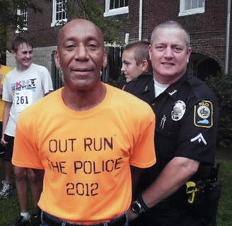 "Bardstown's ""Running Man"" was ""apprehended"" by Bardstown Police Officer Tom Blair at the recent Run for the Health of it event."
