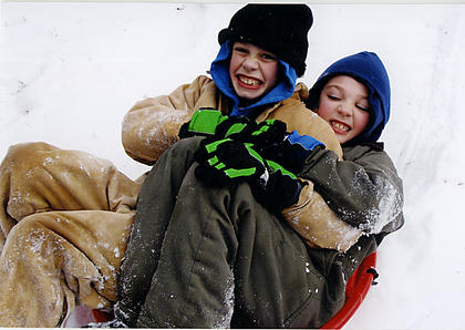 Brothers Nathan and Travis Cambron play in the snow at their grandparents home, Gary and Theresa Clark.