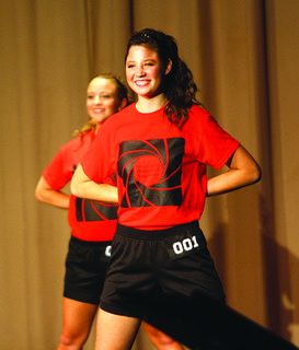 Maggie Finn smiles during the beginning of the fitness portion of the Nelson County Distinguished Young Women. Finn won the scholastic and self expression portion of the event.