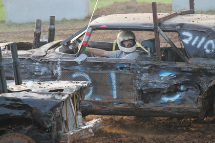 No. 21 Scotty Hinkle of Irvinton, looks back at a competitor. He was the overall winner of the 2013 Demolition Derby at the Nelson County Fair.
