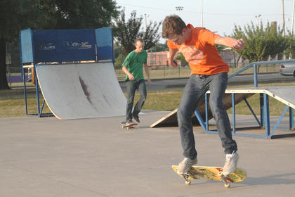 Brett Mattingly, 20, Bardstown, tries a trick at the Bardstown Skate Park July 5 while Jacob Rogers, 19, Bardstown, sets up for his own trick.