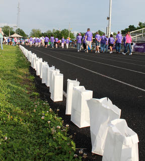 Luminary bags were still accumulating around the Bardstown High School track as cancer survivors made their Survivors Lap, followed by the Caretakers Lap and the Team Lap at the 2011 Relay for Life event.