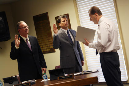 From right, Nelson County Judge Executive Dean Watts, swears in Andy Stone and Franklin Hibbs III to the Bardstown Independent Board of Education Tuesday. 
