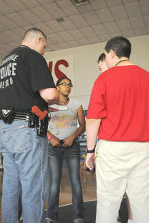 Tonisha Verner (center), Bardstown Police Explorer, meets with her team Tuesday during a training exercise designed to simulate a school shooting.