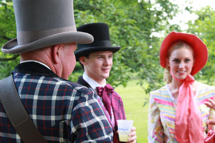 "Gary Vidito, left, who has played banjo and guitar as Stephen's friend in ""The Stephen Foster Story"" for 30 years, speaks with fellow cast members at the Opening Night Gala & Garden Party on the grounds of My Old Kentucky Home June 11."