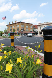 JUNE 1, 2011: Pedestrian traffic islands are placed at three corners of Court Square, two of them complete with landscaping.