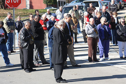 Those attending the Veterans Day ceremony in Bardstown last week bow their head as a prayer is said.