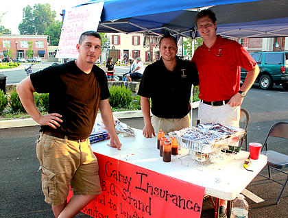 From left, Frank Downs, Patrick Carey and Michael Coen of Parrish and Carey Insurance passed out barbecue and helped sponsor Pauly Zarb's Bardstown Street Concert July 9.