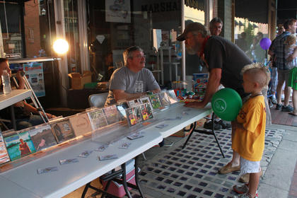 Albums for a number of the artists who performed at Pauly Zarb's Bardstown Street Concert July 9 were on sale on the North Third Street sidewalk.