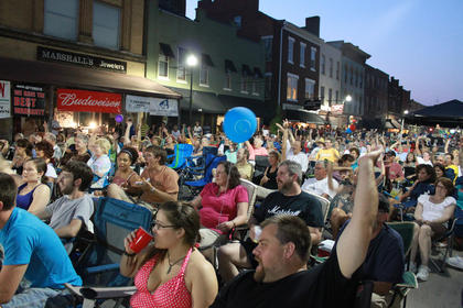 """Ole!"" cries a crowd of perhaps 2,500 or more in time with the music of fingerpicking champion Edgar Cruz at Pauly Zarb's 2011 Bardstown Street Concert on North Third Street in Bardstown July 9. Bardstown Main Street Manager Rita Riley estimated the event drew a crowd of 2,500 or more."