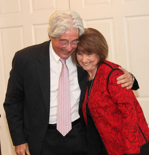Dr. Joe Lanzillo, the chamber's Man of the Year, embraces Dorothy White, executive director of the chamber, upon receiving his award.