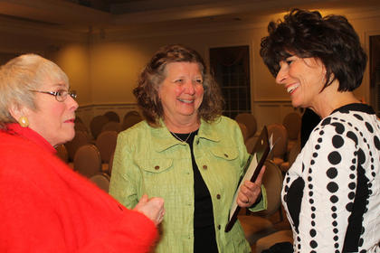 Sally Long,  who started the Butterflies and Blossoms Garden Club and is involved in a variety of volunteer work in Bloomfield, talks with Flaget Nally, left, and Val Downs after the awards dinner.