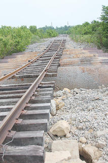 Flooding in May washed away the ballast supporting this train tracks near New Haven.