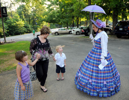 Evyn Riney, 6, Cindy Riney and Layne Riney, 3, Elizabethtown, are greeted by actress Trish Epperson at a special Forth of July Presentation of The Stephen Foster Story at the J. Dan Talbot Ampitheatre Saturday.