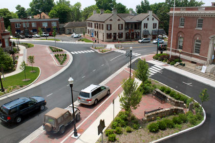 JUNE 1, 2011: Billom Park is newly paved in brick with new benches and landscaping.