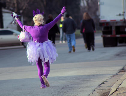 TeriTeri the Alzheime's Fairy encourages participants during the third annual Forget Met Not Fun Run Saturday.