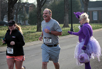 With encouragement from TeriTeri the Alzheimer's Fairy, participants close in on the finish line for the third annual Forget Me Not 5k/one mile Fun Run Saturday.
