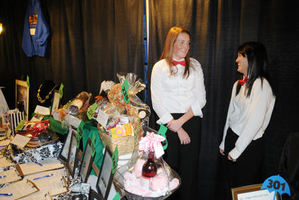 Bethlehem students Hannah Farmer and Asuka Sekiguchi work the silent auction tables at Lights, Camera, Auction!