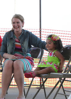 Aubrianna Rose Hinton smiles at the audience at the Nelson County Fair Baby Contest held Thursday, July 19, at the Nelson County Fairgrounds.
