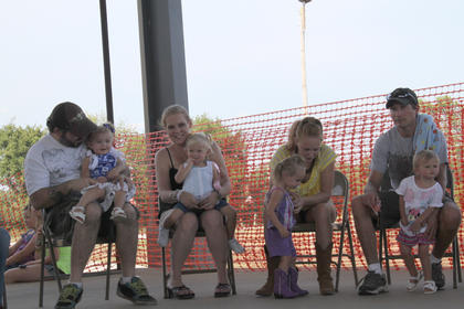 Contestants await their turn at the Nelson County Fair Baby Contest held Thursday, July 19, at the Nelson County Fairgrounds.
