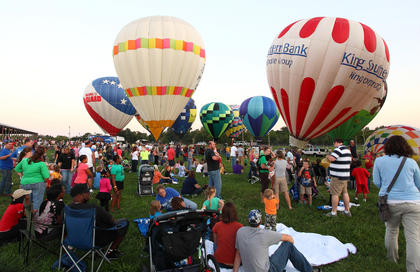 Festival-goers gather to watch the balloon glow as part of the 2012 Kentucky Bourbon Festival.