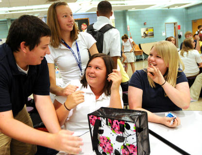 Senior Ben Keylock, Junior Christine Seaman, Senior Kelley Ries and Senior Megan Cecil hang out in the cafeteria before going to homeroom on the first day of school at Bardstown High School Wednesday.