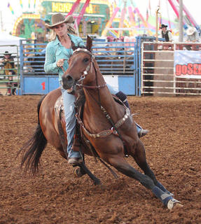 Lynzie Young, Louisville, makes the turn during the barrel racing competition Wednesday at the Nelson County Fair.