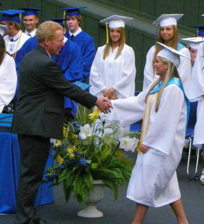 Bethlehem High School Principal Tom Hamilton presents Olivia Simpson with her diploma during the high school's class of 2014 graduation.