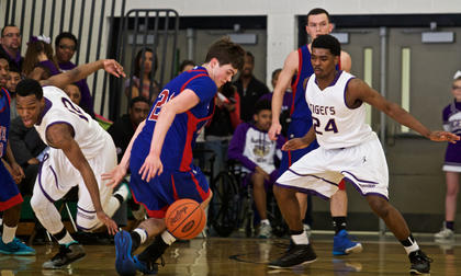 Bardstown's L.J. Cowherd, left, and Voshon Livers, right, pressure Adair County's Noah Polston in the first half of the Tigers' 59-38 win in Saturday's 5th Region quarterfinals at Green County.