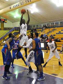 Bardstown&#039;s Seivon Schooling goes up for a jumper against Christian County during the Bardstown Boys and Girls Christmas Classic. The Tigers got the win after dropping a decision to the Colonels just the week before.