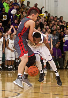 Bardstown's L.J. Cowherd, right, is fouled by Taylor County's Austin Webster after a steal in the Tigers' 58-39 loss in Tuesday's 5th Region championship.