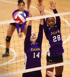 Morgan Milburn (14) and Sherelle Smith of Bardstown go for a block Tuesday against Thomas Nelson.