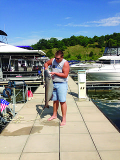 This 30-pound blue cat was caught on a noodle at Taylorsville Lake by Justin Evans and his Papaw Charlie Tingle.